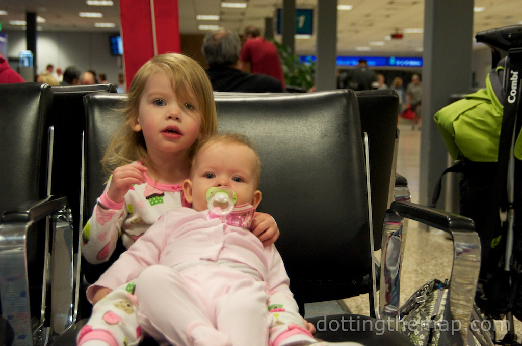 Little girls waiting to board a red-eye flight to NYC