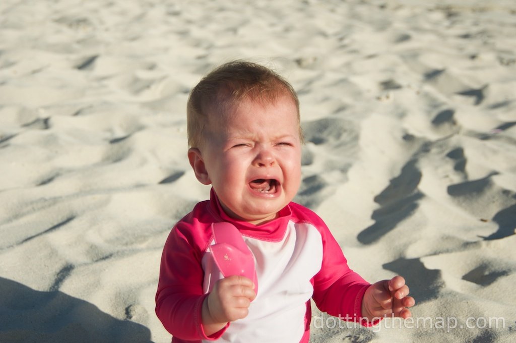 crying baby on beach